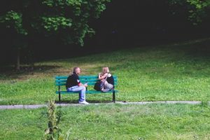 couple talking in park